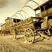 Wild west Cowboy town with wagon in foreground.